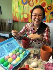 PSP student Ningyu decorates Easter eggs.